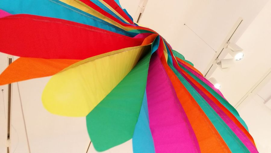 Low Angle View Of Multi Colored Paper Decoration