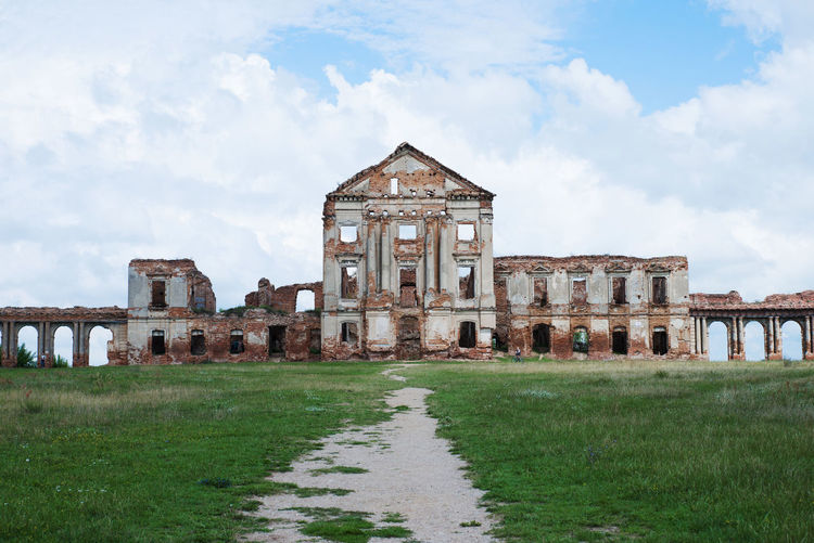 Abandoned Building Against Cloudy Sky