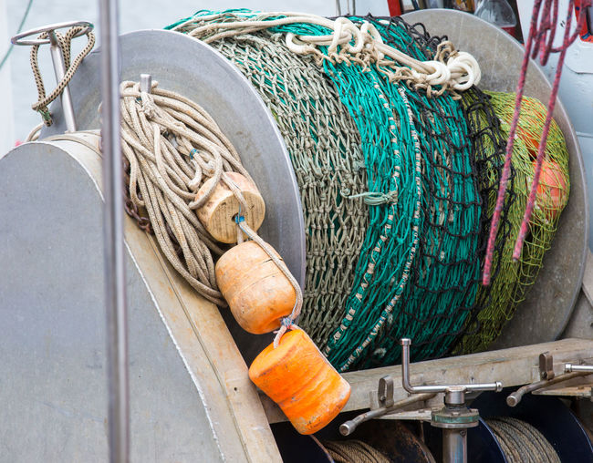 a wrapped trawl on a fishing boat Fishing Fishing Industry Fishing Net Rope No People Buoy Day Fishing Rod Metal Fishing Boat Fishery  Fishing Net Trawl Fishing Quota Sea Environmental Protection Unsuccessful Problem