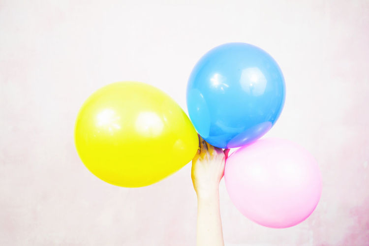 Balloon Multi Colored Celebration Yellow Group Of Objects Helium Balloon No People Close-up Indoors  Blue Vibrant Color Studio Shot Variation White Background Medium Group Of Objects String Cut Out Pink Color Choice