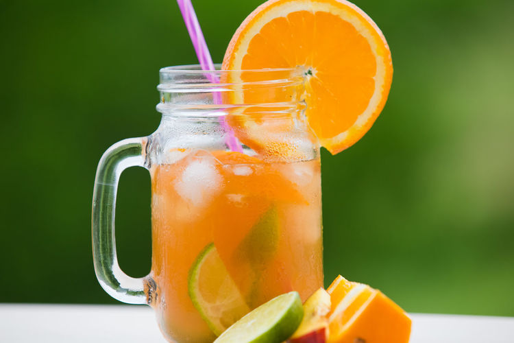 Close-up of drink in glass jar