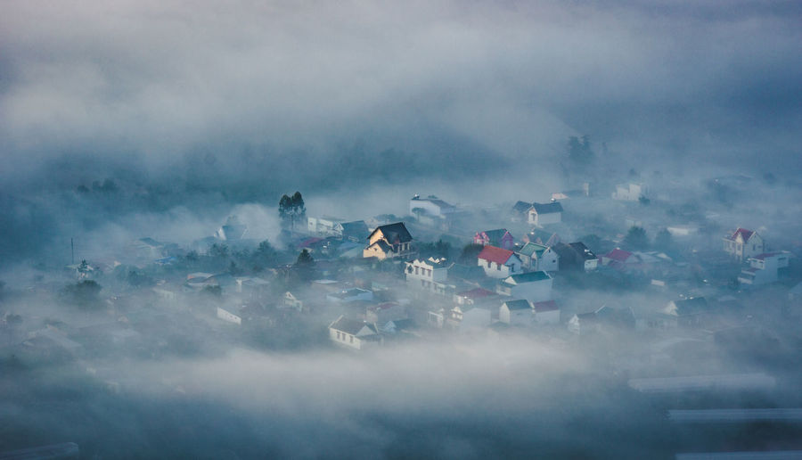 Aerial view of townscape during foggy weather