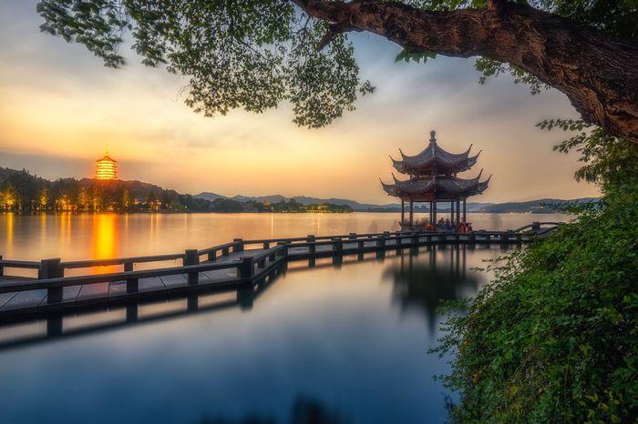 杭州西湖长桥 Landscape XiHu Hangzhou 西湖 Westlake Religion Tree Architecture Sunset Water Built Structure Spirituality Place Of Worship Outdoors Nature Travel Destinations Building Exterior No People Sky Beauty In Nature Day
