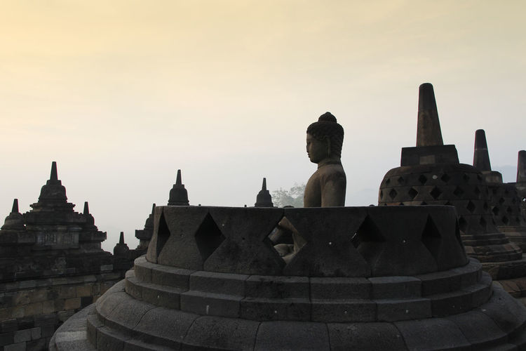 Silhouette Borobudur Temple with the Buddha statue during sunrise, Yogyakarta, Indonesia Borobudur Temple Yogyakarta Ancient Ancient Civilization Architecture Belief Buddhism Building Built Structure Dawn History No People Place Of Worship Religion Sky Spirituality Stone Material Sunrise The Past Tourism Travel Travel Destinations