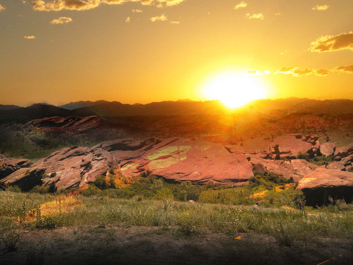 Orange Sky Sunlight Sunset_collection Beauty In Nature Day Enhanced Photograph Field Grass Landscape Mountain Mountain Range Nature No People Orange Color Outdoors Scenics Sky Sun Sunlight Sunlit Sunlit Clouds Sunset Tranquil Scene Tranquility