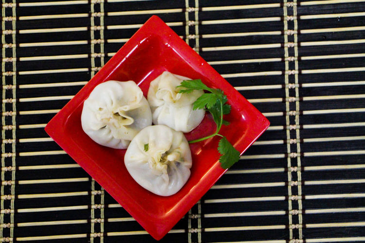 Directly above shot of momos served in plate on table