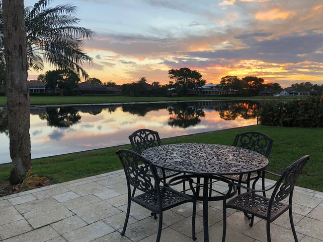 Patio Beauty In Nature Cloud - Sky Day Lake Nature No People Outdoors Patio Furniture Scenics Sky Sunrise Sunset Table Tree Water