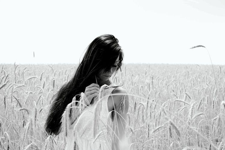 Rear view of woman in field