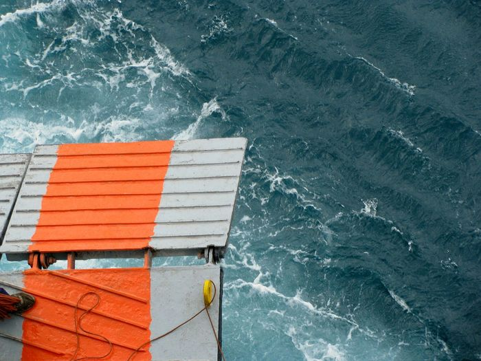 TakeoverContrast On A Ship Ship Door Back Door Ferry Boat Gangway Sea Arriving Docking Shades Of Blue Greywater Orange Color Door Doors Ferry Boat Door Human Foot Foot Contrast Blue Sea Transportation Dramatic Angles Directly Above Long Goodbye