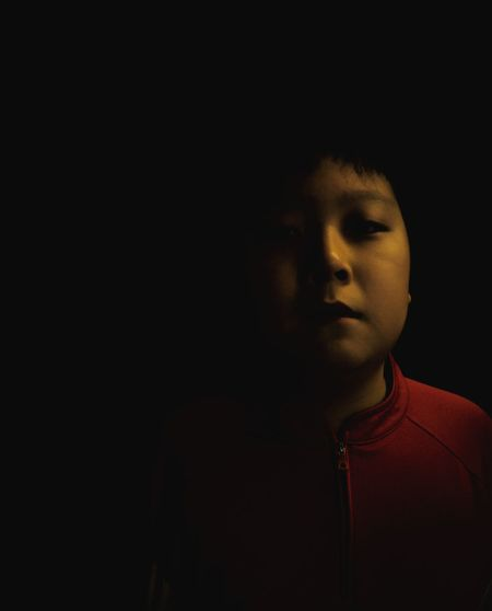Portrait Street Boy One Boy Red Black Black Background One Person Young Adult Lifestyles Real People Headshot Childhood Close-up People Indoors