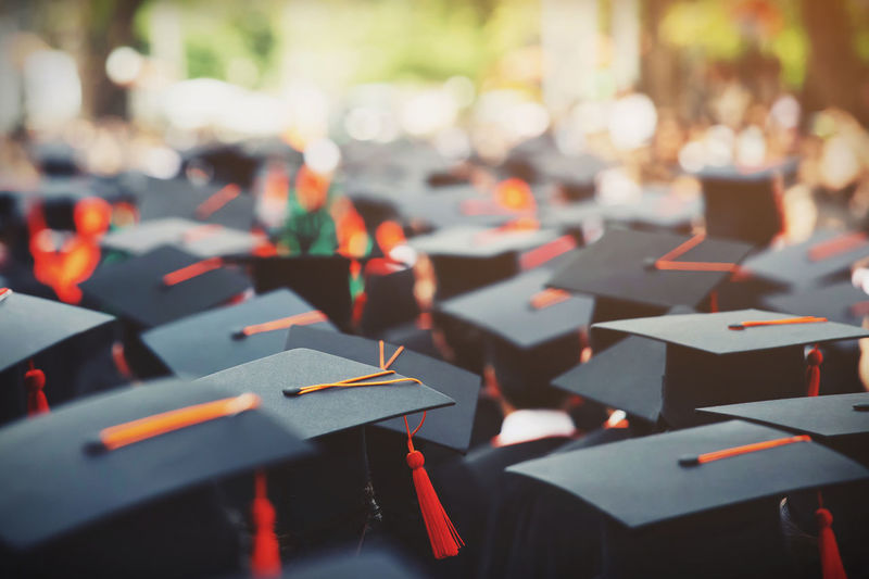 Shot of graduation hats during commencement success graduates of the university,