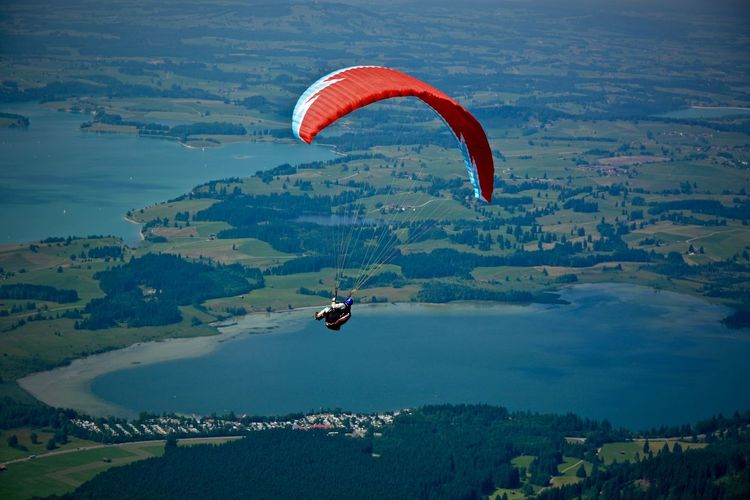 Person paragliding in sky