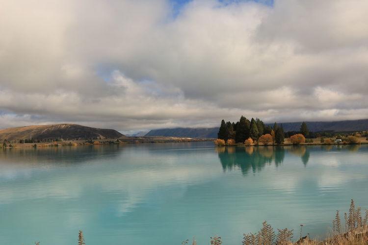 Idyllic shot of lake pukaki against cloudy sky