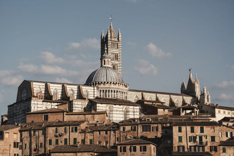 The Duomo of Siena. Duomo Tuscany Architecture Belief Building Building Exterior Built Structure City Cloud - Sky Day Gothic Style History Italy Nature No People Place Of Worship Religion Sky Skyscraper Spire  Spirituality The Past Tourism Travel Travel Destinations
