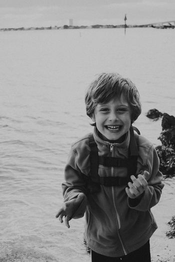 Childhood Looking At Camera Water Portrait Smiling Real People Boys Happiness One Person Standing Day Nature Leisure Activity Lifestyles Beach Outdoors Sea Elementary Age Vacations Sky