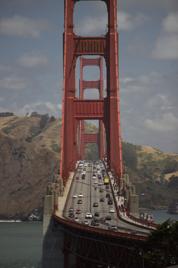 High Angle View Of Vehicles Moving On Golden Gate Bridge Against Sky