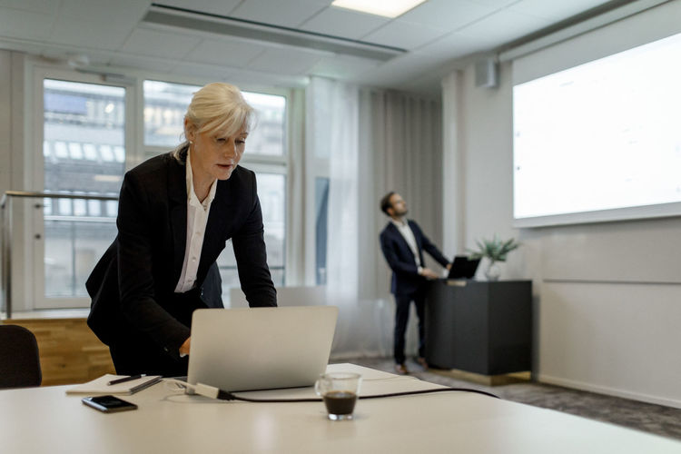 Two people working in office