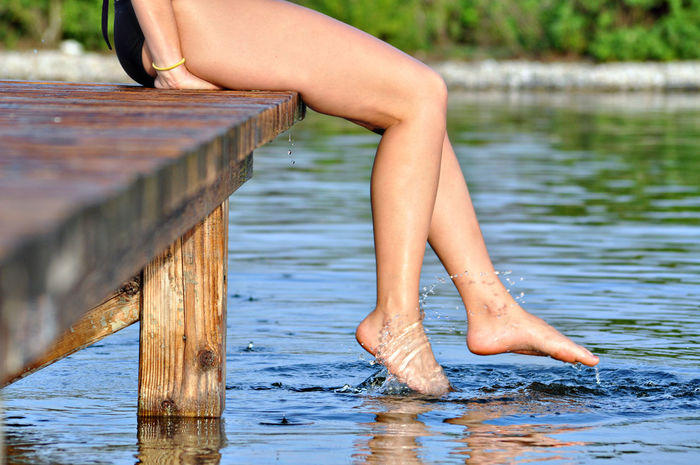 Chilling Copy Space Relaxing Adult barefoot Body Part Day depth of field Human Body Part Human Foot Human Leg Joy Lake Leisure Activity Lifestyles Nature One Person Outdoors Pier Real People Relaxation Summer Water Women Wood - Material