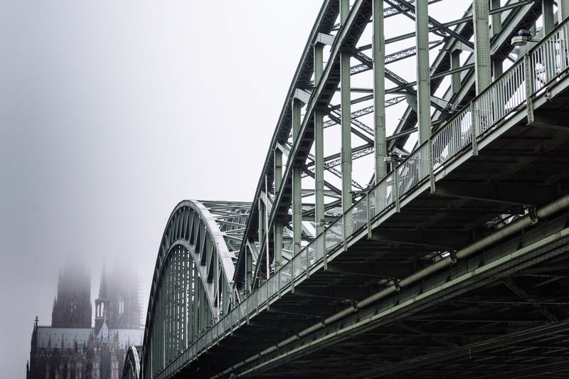 Low Angle View Of Suspension Bridge In Foggy Weather