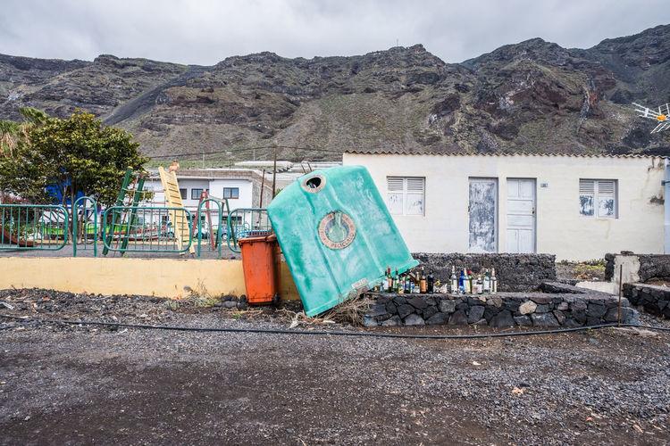 Abandoned building against mountain range