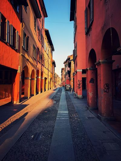 Bologna at the afternoon Bologna Italy Beutiful Place  Beautiful City Old Houses City Diminishing Perspective Architecture Building Exterior Sky Built Structure Empty Road City Gate The Traveler - 2018 EyeEm Awards