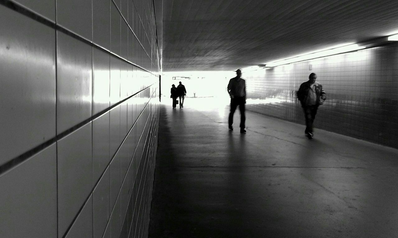 indoors, walking, men, women, real people, silhouette, illuminated, full length, architecture, day, people