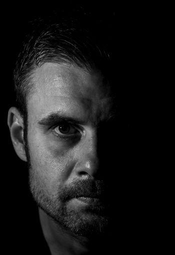 Black Background Portrait Human Face Looking At Camera Studio Shot Headshot Close-up