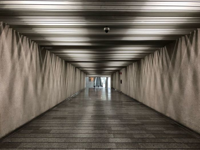 Direction The Way Forward Architecture Lighting Equipment Illuminated Ceiling EyeEmNewHere Indoors  Built Structure Diminishing Perspective Tunnel Wall - Building Feature Corridor