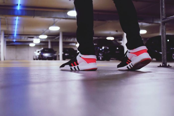 Low Section Human Leg Indoors  Human Body Part Multi Colored Focus On Foreground Illuminated Parking Garage Parking Lot Urban Eqt Adidas