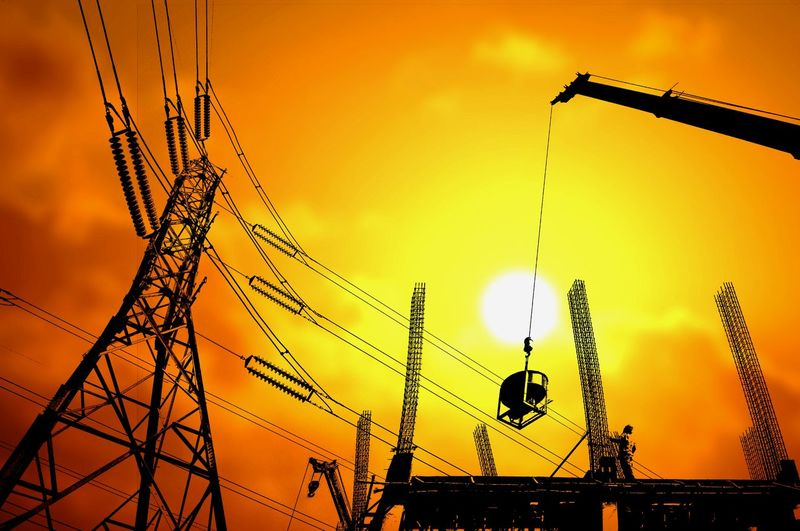 Silhouette construction site and high voltage pole with blurred sundown sky background in construction development concept Technology Development Prosperity Crane Colorful Double Exposure High Voltage Pole Construction Structure Sundown Morning Evening Shadow Reinforcement Steel Equipment Tools Worker Working Occupation EyeEm Selects Sunset Silhouette Sky No People Outdoors Nature Architecture Day