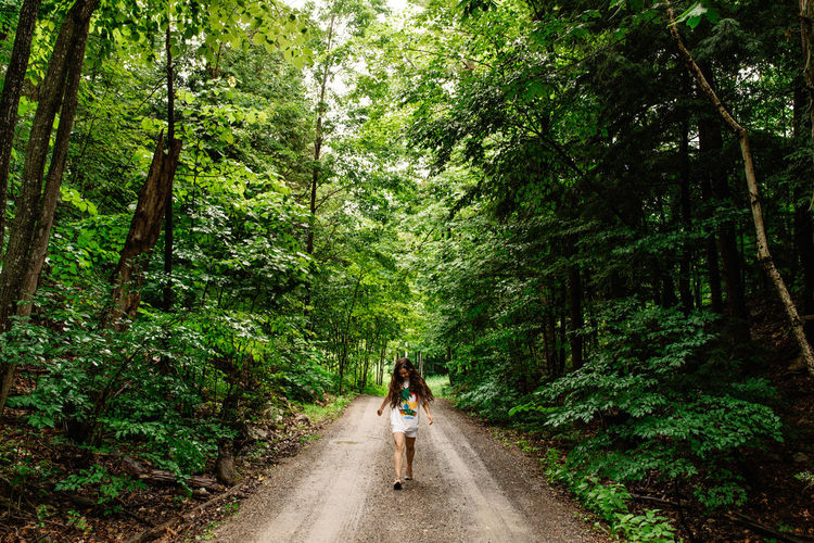 Adventure ahead Composition Cottage Day Forest Getting Away From It All Girl Green Green Color Hiking Leading Lush Foliage Narrow Nature Non-urban Scene Outdoors Perspective Relaxing Moments Rock Rock Formation Scenics The Way Forward Tranquil Scene Tranquility Tree Vanishing Point