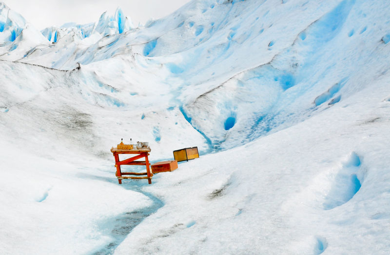 Wooden Table And Boxes On Glacier
