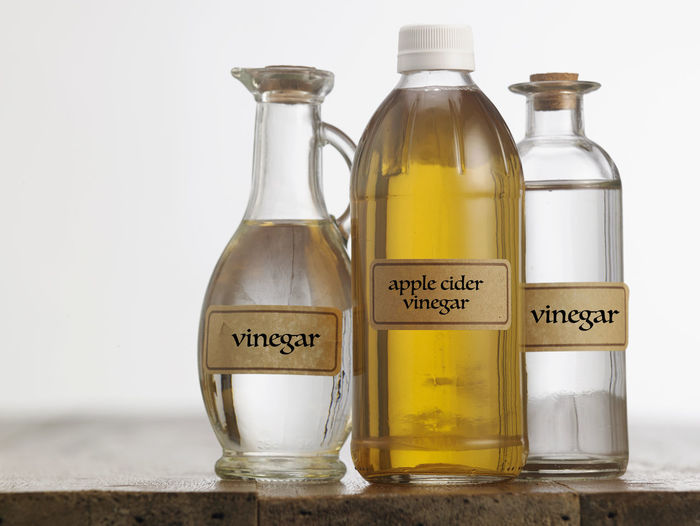 apple cider vinegar and white vinegar on the wooden table top Cooking Food And Drink Liquid Natural Acetic Apple Cider Vinegar Bottle Clear Close-up Condiment Container Food Glass - Material Indoors  Ingredient Label No People Savory Food Studio Shot Table Top Taste Text Transparent Water White Vinegar