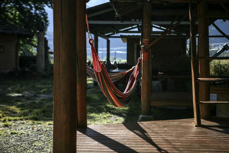 Hammocks hanging in gazebo on sunny day