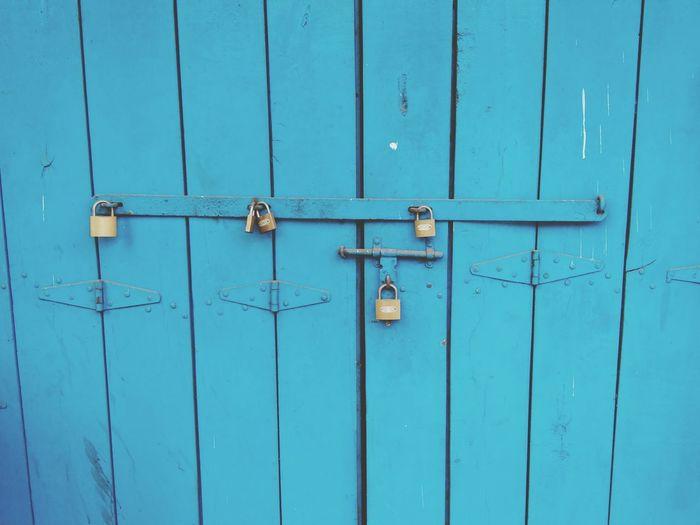 Locks on blue wooden door