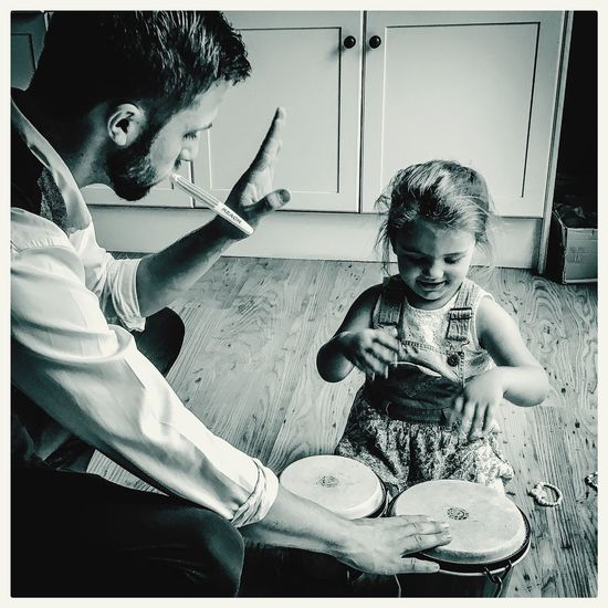Knowledge Is Power Teaching Percussion Drums Skills  Musician Music Family Love Monochrome Special Moment Blackandwhite Black And White Portrait The Portraitist - 2016 EyeEm Awards Hello World Storytelling Taking Photos Loving Life! Gallery Photography Check This Out Sharing  Telling Stories Differently Best Seat In The House