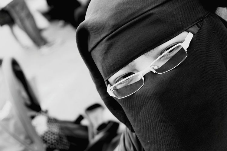 Close-up of woman wearing burkha and eyeglasses