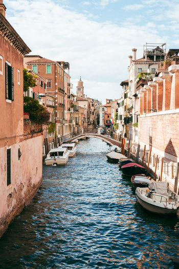 Pastel Cityscape Moored Boats Narrow Pastel Power Quiet Tranquility Travel Photography Venice, Italy Architecture Boats Building Exterior Built Structure Canal City Day Italy Moored Nautical Vessel No People Outdoors Pastel Colors Sky Travel Destinations Venice Water