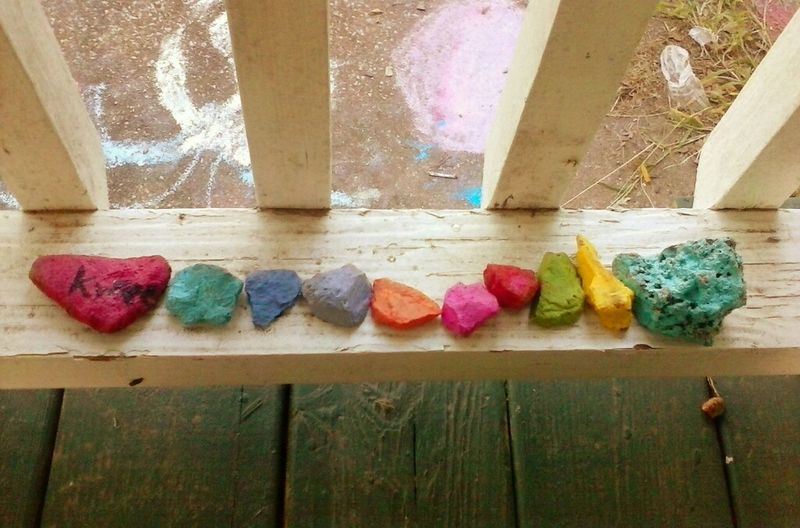 Multi Colored Variation Outdoor Photography Rocks Childhood Painted Rocks Porch Wood Porch White Wooden Railing Capture The Moment EyeEm Gallery ThroughMyLens Eye4photography  Personal Perspective EyeEm Best Shots Best Shots EyeEm Fun Child Happiness