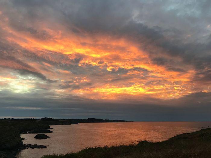 Feu du soir Sky Cloud - Sky Water Beauty In Nature Sunset Scenics - Nature Sea No People Dramatic Sky Orange Color Non-urban Scene Tranquility