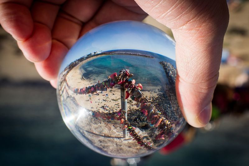 Love ball Ronny Best Pictures Authentic Arts Romantic Beach Seaside Iron Chain Human Hand Hand Human Body Part One Person Holding Body Part Human Finger Finger Close-up Focus On Foreground Reflection Lifestyles Day Outdoors Sphere Nature Glass - Material Nail