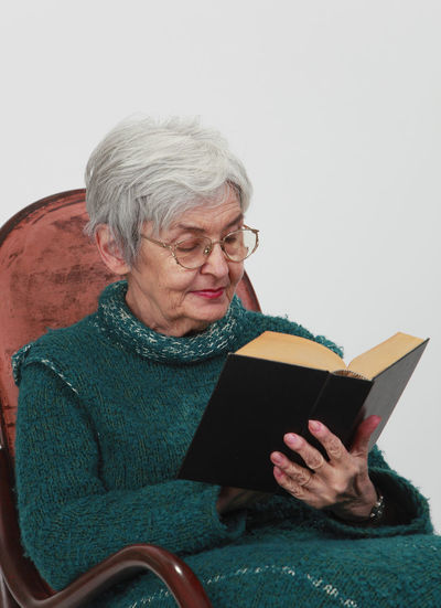 Portrait of an old woman reading a black book Senior Adult Senior Women One Person Book Sitting Reading Lifestyles Adult Leisure Activity Real People Gray Hair Woman Old Woman Senior Woman Woman Reading Reading A Book Old Woman Reading A Book Senior Education Novel Bible Study Glasses Portrait Of A Woman