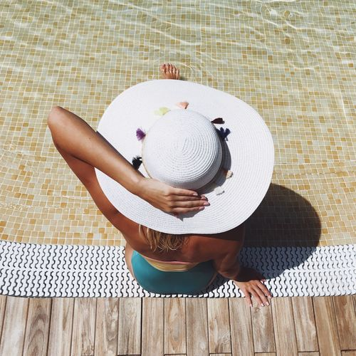 One Person Women Real People Hat Lifestyles Leisure Activity Adult Relaxation Day Human Body Part High Angle View Flooring Directly Above Casual Clothing Pattern Unrecognizable Person Obscured Face Clothing Sitting Mat