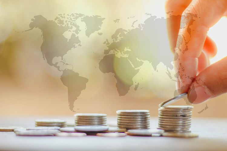 save money and investment concept with coin stack growing graph with sunlight, selective focus Economy Loan  Market Statistic Accounting Business Cash Close-up Coin Earnings Finance Finger Hand Holding Keep It Blurry Money One Person Real People Save Wealth