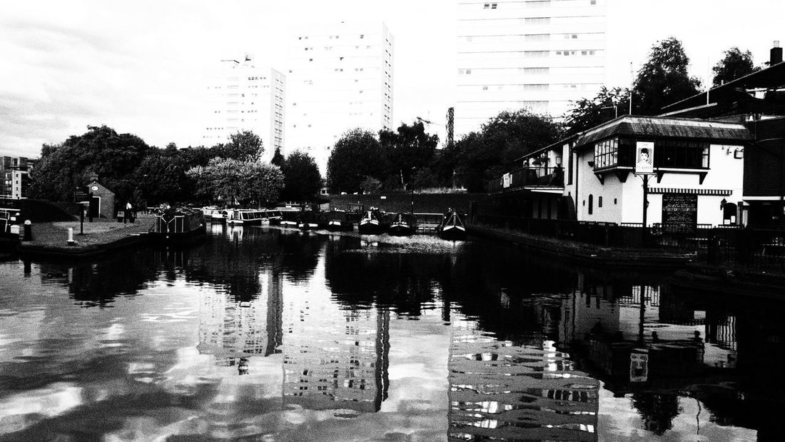 Reflection Architecture Building Building Exterior Built Structure Canal City Day Lake Mode Of Transportation Nature No People Outdoors Plant Reflection Residential District Sky Transportation Tree Water Waterfront