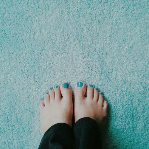 Close-up of human legs with nail varnish