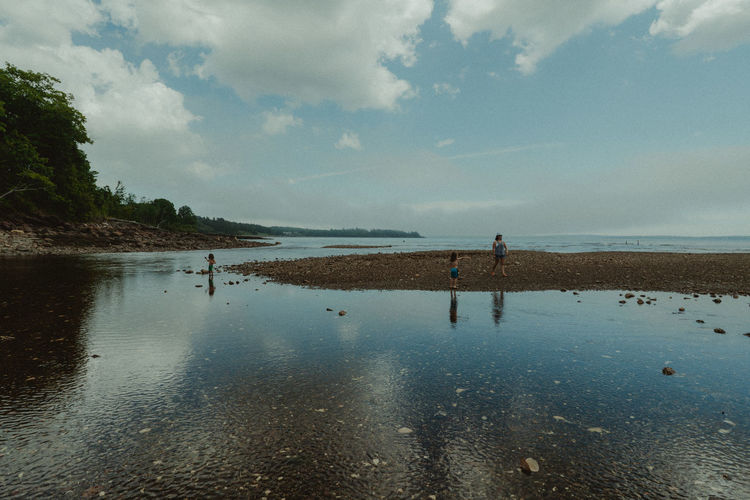 Blue Sky Camden Maine Clear Blue Sky Clear Water Family At The Beach Family Play Family❤ Islandlife Kids Playing At The Beach Kids Playing In Water Low Tide Sky And Clouds Sky Reflected In Water Summertime