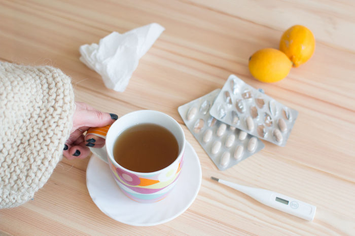 Tea Teamwork Tissue Cold Epidemic Fiber Flu Germs Grippe Health High Temperature Human Hand Illness Infection Patient Prevention Sick Sickness Table Thermometer Tissue Paper Treatment Virus Vitamin Vitamin C