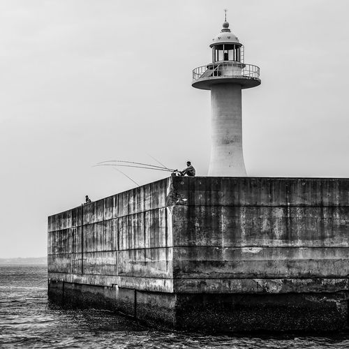 """""""it's time to fish"""" Architecture Built Structure Building Exterior Water Tower Lighthouse Guidance Sky Day Nature Building Sea Outdoors Nautical Vessel Clear Sky Fishing Fisherman"""