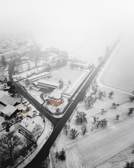 DJI X Eyeem December Decisions Fork In The Road From Above  Houses January Unknown Weather Winter Aerial Photography Cold Temperature Contrast Day Dronephotography Flying Fog Landscape Outdoors Parting Of Ways Rural Area Small Town Snow Town White 17.62°